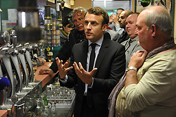 'En marche!' candidate for the presidential elections Emmanuel Macron meets local residents in a pub as part of a campaign trip ahead of the second round, in Bully-les-Mines, northern France on April 26, 2017. Photo by Alcalay/Pool/ABACAPRESS.COM