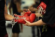 La Habra,California - Boxer Ricardo P. Garcia gloves are removed during training at the La Habra Boxing Gym, April 26th 2012  <br /> <br /> Photo by Darin Sicurello  Sports Shooters Academy IX<br /> La Habra Boxing Gym, April 26th 2012 by Darin Sicurello  Sports Shooters Academy IX