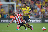 Oriol Romeu of Southampton fouls Etienne Capoue of Watford. Barclays Premier League, Watford v Southampton at Vicarage Road in London on Sunday 23rd August 2015.<br /> pic by John Patrick Fletcher, Andrew Orchard sports photography.