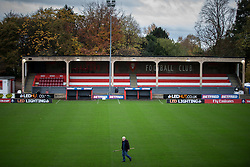 © Licensed to London News Pictures . 06/11/2015 . Salford , UK . A groundsman prepares the pitch . TV crews and volunteers at the club set up for the FA Cup match between Salford City FC and visitors Notts County , at the club's Moor Lane ground . Photo credit : Joel Goodman/LNP