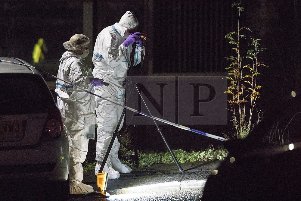 © Licensed to London News Pictures . 26/10/2017. Accrington , UK . Police and forensic examiners on Barnard Close where a 32 year old man was shot in the chest , earlier this evening and later died . A 14 year old boy from Accrington has been arrested on suspicion of murder and Lancashire Police are conducting a murder enquiry . Photo credit: Joel Goodman/LNP