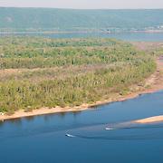 Quay with motor boats on island in Volga near Samara city