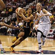 Skylar Diggins, Tulsa Shock, drives to the basket past Katie Douglas, (right), Connecticut Sun, during the Connecticut Sun Vs Tulsa Shock WNBA regular season game at Mohegan Sun Arena, Uncasville, Connecticut, USA. 3rd July 2014. Photo Tim Clayton