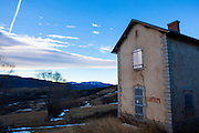 Abandoned railway building, Cerdagne, France. The Train Jaune, Yellow Train, Canari, or Ligne de Cerdagne, is a 63km long railway from Villefranche-de-Conflent to Latour-de-Carol, rising from 427m to 1,593m at Bolquère-Eyne, the highest railway station in France. In early 2015 the future of the line was uncertain, with SNCF and the French government considering either to close the line, or to privatise it for tourism use.