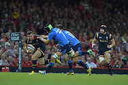 caption correction : Gareth Davies of Wales breaks away from the tackle from Italy's Francesco Minto. Wales v Italy, RWC warm up international match at the Millennium Stadium in Cardiff ,South Wales on Saturday 5th Sept  2015. pic by Andrew Orchard, Andrew Orchard sports photography.