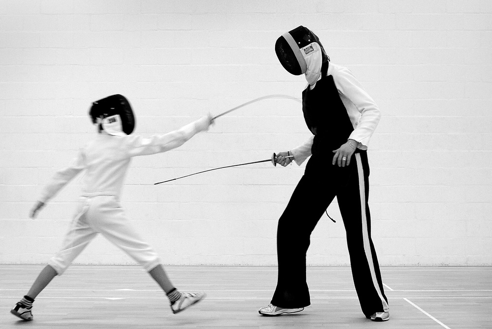 Netherlands. Amsterdam, 06-04-2005. Photo: Patrick Post.<br /> Old champions fencing Pernette Osinga and Bep van der Pol give fencing classes to youth at Fencing Academy Hall of Oeveren which was established on November 9, 1971 by the then Maître and founder R. Oeveren. In the summer of 1991 Maître Oeveren moved to France to teach and started in Chateau des Sablons a Fencing Museum. The members of the Association have then decided to make a new start under his name: ASV.