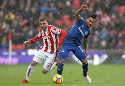 Stoke City's Kostas Stafylidis (left) and Everton's Theo Walcott battle for the ball