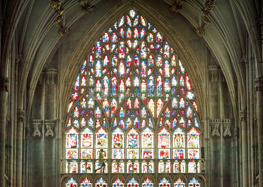 Lead Labourer Andy Bracegirdle walks in front of the 600-year old Great East Window in York Minster, as work is completed in a decade-long project to conserve and restore the largest expanse of medieval stained glass in the country.