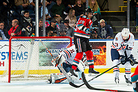 KELOWNA, BC - NOVEMBER 16:  Leif Mattson #28 of the Kelowna Rockets jumps out of the way of the puck as Dylan Garand #31 of the Kamloops Blazers defends the net and makes a save at Prospera Place on November 16, 2019 in Kelowna, Canada. (Photo by Marissa Baecker/Shoot the Breeze)