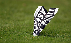 Close up of a 'United Against Ashley' banner folded into a paper plane lands on the pitch