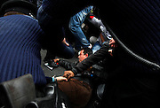 Police officers try to drag anti-Gaddafi protesters away from the middle of the road after they attempted to approach the Libyan Embassy in Attard, outside Valletta, March 21, 2011. Several arrests were made when anti-Gaddafi protesters threw stones at pro-Gaddafi demonstrators and tried to approach the embassy gates, according to local media...REUTERS/Darrin Zammit Lupi (MALTA)