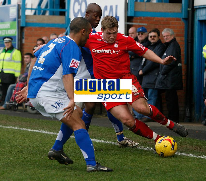 Kris Commons of Nottingham Forest (left) attacks Chesterfield defender Alex Bailey (left)
