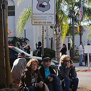 Residents sit and wait as law enforcement officers search for suspect Markeith Loyd at the Tzadik Brookside Apartments on January 9 2017 in Orlando, Florida. Loyd shot an Orlando Police officer earlier in the day at a local Walmart, the officer has since died.  (Alex Menendez via AP)