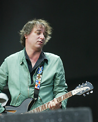 Peter Buck, of the band REM, headline the main stage on Saturday, T in the Park 2003..Pic: © Michael Schofield.