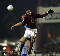 Photo: Chris Ratcliffe.<br />Arsenal v Wigan Athletic. Carling Cup. 24/01/2006.<br />Gilberto and Graham Kavanagh go up for an aerial one