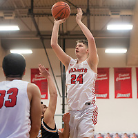 Grants Pirate Colton Moore (24) takes a shot against St. Pius X Sartans Saturday at Grants High School in Grants. Grants took the win 60-52.
