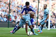 Vincent Kompany of Man city holds off Chelsea's Diego Costa. Barclays premier league match, Manchester city v Chelsea at the Etihad stadium in Manchester,Lancs on Sunday 21st Sept 2014<br /> pic by Andrew Orchard, Andrew Orchard sports photography.