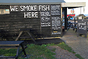 Sheds selling fresh and smoked fish on the beach at Aldeburgh, Suffolk, England, UK