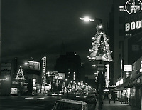 1966 Looking west on Hollywood Blvd. from McCadden Pl. near Coffee Dan's at night.