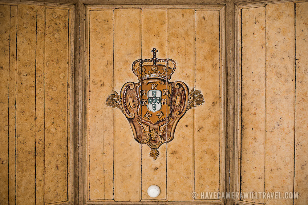 SINTRA, Portugal - An 18th century painting of a crown on the ceiling of what is now known as the Crown Chamber (Sala da Coroa). The Palace of Sintra (Palácio Nacional de Sintra) is a mediaeval royal palace in Sintra and part of the UNESCO World Heritage Site that encompasses several sites in and around Sintra, just outside Lisbon. The palace dates to at least the early 15th century and was at its peak during the 15th and 16th centuries. It remains one of the best-preserved royal residences in Portugal.
