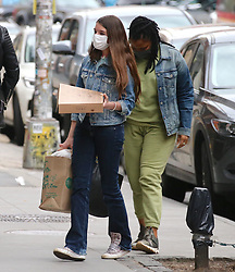 Katie Holmes and Tom Cruise's daughter Suri Cruise is celebrating her birthday over the weekend in New York. On saturday, Suri is spending some time with friends, they are walking in Soho, bought ice cream and flowers nearby her house. On sunday, Katie Holmes and Suri are leaving their house early the morning on her 15th anniversary then few hours after Suri came back home in the evening with her nanny carry on some presents and donuts from Doughnut Plant store in New York, NY on April 18, 2021.<br /> Photo by Dylan Travis/ABACAPRESS.COM