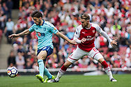 Aaron Ramsey of Arsenal and Harry Arter of AFC Bournemouth battle for possession . Premier league match, Arsenal v AFC Bournemouth at the Emirates Stadium in London on Saturday 9th September 2017. pic by Kieran Clarke, Andrew Orchard sports photography.