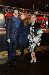 Left to right, GEORGE WAUD, his wife CHARLOTTE TILBURY-WAUD and her mother PATSY TILBURY at the Quintessentially Foundation and The Crown Estate's Fayre of St.James' on 27th November 2014.  The evening started with a christmas concert at St.James's Church, Piccadilly.  Following the concert singer Leona Lewis switched on the Jermyn Street Christmas lights and then guests had a party at the newly refurbished Quaglino's, 16 Bury Street, London