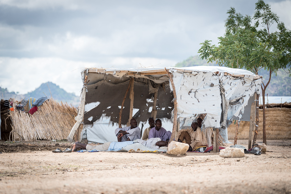 30 May 2019, Mokolo, Cameroon: A group of men rest in the Minawao camp. The Minawao camp for Nigerian refugees, located in the Far North region of Cameroon, hosts some 58,000 refugees from North East Nigeria. The refugees are supported by the Lutheran World Federation, together with a range of partners.