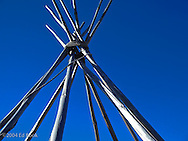 teepee poles are tied together at the tops against a blue sky in Oklahoma, USA