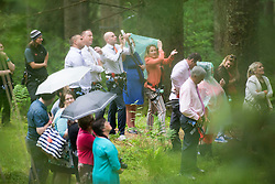 Family and friends watching Martin Milner and Colette Gregory tying the knot in the trees at Go Ape Aberfoyle.