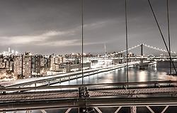 THEMENBILD - Die Brooklyn Bridge ist eine Schraegseil- und Haengebruecke in New York City und ist eine der aeltesten Bruecken dieses Typs in Amerika. Fertiggestellt 1883, verbindet sie Manhattan mit Brooklyn ueber den East River, im Bild die Skyline von Manhattan mit der Manhattan Bridge mit einer Belichtungszeit von 10 Sekunden, Aufgenommen am 28. August 2016 // The Brooklyn Bridge is a hybrid cable-stayed/suspension bridge in New York City and is one of the oldest bridges of either type in the United States. Completed in 1883, it connects the boroughs of Manhattan and Brooklyn by spanning the East River. This picture shows the skyline of Manhattan with the Manhattan Bridge with an exposure time of 10 seconds, New York City, United States on 2016/08/28. EXPA Pictures © 2016, PhotoCredit: EXPA/ Sebastian Pucher