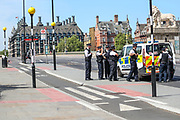 Additional police arrive to assist with an arrest at St Thomas' Hospital, with security personnel saying that the arrest needed to be done for medical reasons on Tuesday, May 5, 2020. Office for National Statistics (ONS) said on Tuesday that more people have died in the United Kingdom from coronavirus than any other European country. (Photo/Vudi Xhymshiti)