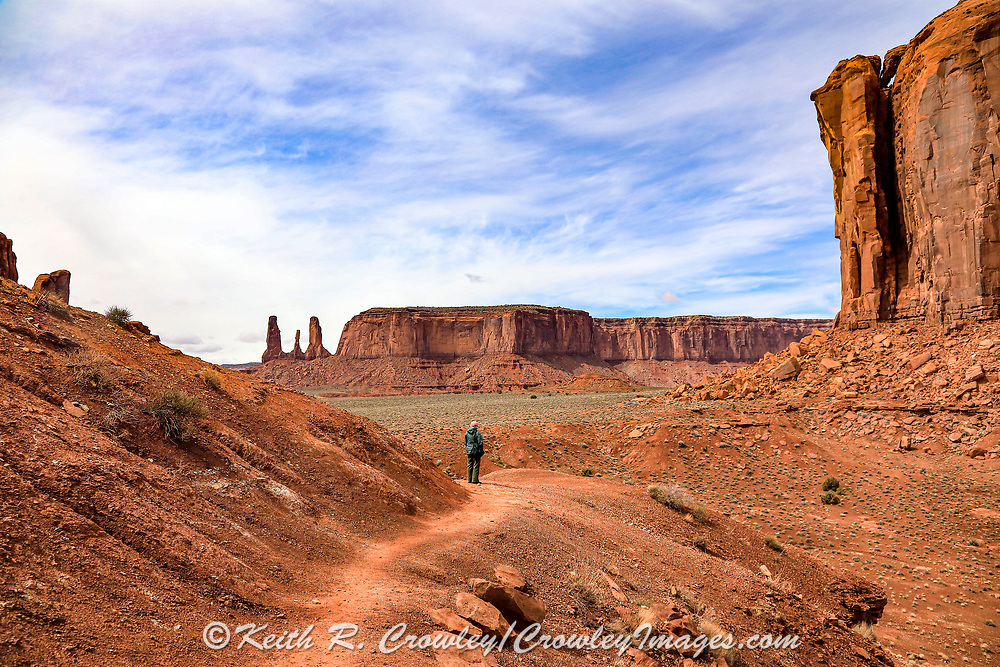 A visitor enjoys one of the many vistas in Monument Valley on the Utah-Arizona Border