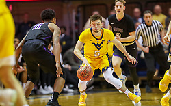 Mar 20, 2019; Morgantown, WV, USA; West Virginia Mountaineers guard Jordan McCabe (5) steals the ball during the second half against the Grand Canyon Antelopes at WVU Coliseum. Mandatory Credit: Ben Queen