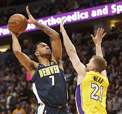 March 9, 2018 - Denver, Colorado, U.S - Nuggets TREY LYLES, left, goes up for a basket with Lakers TRAVIS WEAR, right, during the 2nd. Half at the Pepsi Center Friday night. The Nuggets beat the Lakers 125-116  (Credit Image: © Hector Acevedo via ZUMA Wire)