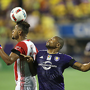 ORLANDO, FL - JUNE 18:  Anibal Godoy #30 of San Jose Earthquakes heads the ball in front of Julio Baptista #19 of Orlando City SC during an MLS soccer match between the San Jose Earthquakes and the Orlando City SC at Camping World Stadium on June 18, 2016 in Orlando, Florida. (Photo by Alex Menendez/Getty Images) *** Local Caption *** Anibal Godoy; Julio Baptista