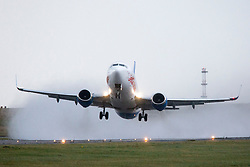 © Licensed to London News Pictures. 03/01/2018. Leeds, UK. A Jet 2 aircraft takes off in strong winds this morning at England's highest airport, Leeds Bradford international as storm Eleanor batters the country. Photo credit: Andrew McCaren/LNP