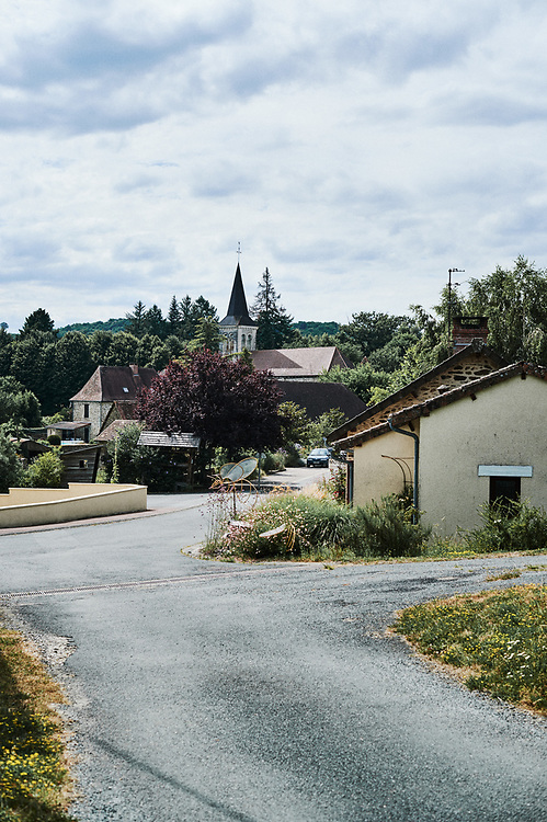 A view of the village, including the church. Saint-Pierre-de-Frugie, France. July 12, 2019.