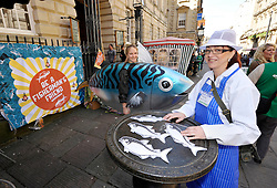 © Licensed to London News Pictures. 12/05/2012. Bristol, UK. Picture of Zoe Strickland in fish costume and Suzie Winters as a fishmonger at the historic nails by the Corn Exchange in Corn Street, Bristol, part of the Greenpeace south west launch of Be A Fisherman's Friend campaign on supporting sustainable fishermen, getting the public's support.  12 May 2012..Photo credit : Simon Chapman/LNP