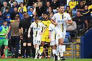 Curtis Nelson (5) of Oxford United is shown a yellow card, booked during the EFL Sky Bet League 1 match between Oxford United and Burton Albion at the Kassam Stadium, Oxford, England on 25 August 2018.