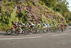 © Licensed to London News Pictures. 10/09/2014. Bristol, UK.  The Tour of Britain reaches Bristol.  Picture shows the race up the steep hill of Bridge Valley Road from the Avon Gorge with Brunel's Suspension Bridge towards the finish for the day. Photo credit : Simon Chapman/LNP
