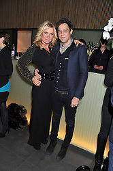 "MEG MATHEWS and JAMIE HINCE at a party to celebrate the launch of Meg Matthews' blog - ""Meg says"" at the bar at Ni Ju San, 23 St.James's Street, London on 1st December 2011."