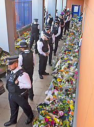 ©Licensed to London News Pictures 28/09/2020  <br /> Croydon, UK. Members of the Metropolitan Police Territorial Support Group looking at the flowers placed for Sgt Matt Ratana at Croydon Custody Centre. The murder investigation continues after the death of police sergeant Matt Ratana at the Croydon Custody Centre in South London last week. Photo credit:Grant Falvey/LNP