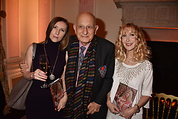Left to right, Polina Colebat, Naim Attallah and Basia Briggs at a reception to celebrate the publication on 'Mother Anguish' by Basia Briggs held in The Music Room, The Ritz Hotel, 150 Piccadilly, London, England. 04 December 2017.