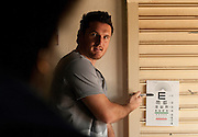 Graeme Smith and other international Oakley athletes join Oakley in helping Mamelodi community members improve their vision by offering free eye testing and prescription eyewear. Mamelodi, Pretoria, South Africa. Images by Greg Beadle