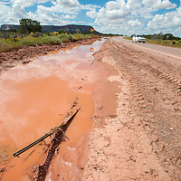 091813        Brian Leddy<br /> Water stands on the side of the Highway 53 Wednesday. Recent rains brought flooding to the Zuni area.