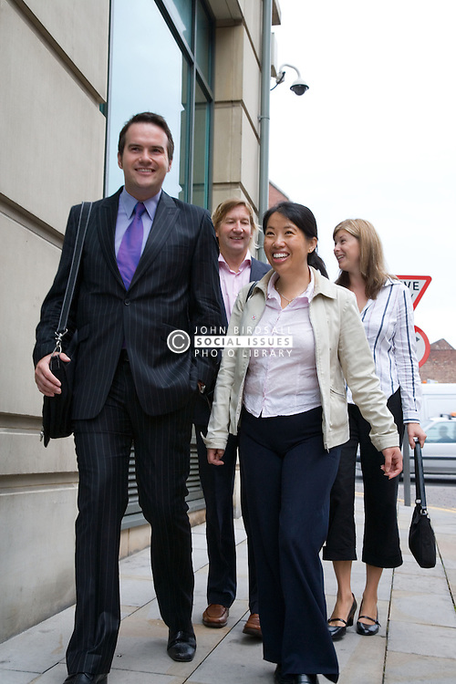 Four adults walking to work,