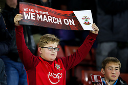 "A younf Southampton fan holds up a banner reading ""we march on"" - Photo mandatory by-line: Rogan Thomson/JMP - 07966 386802 - 03/03/2015 - SPORT - FOOTBALL - Southampton, England - St Mary's Stadium - Southampton v Crystal Palace - Barclays Premier League."
