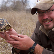 """Our guide at Malamala, Johnathan with a South Africa.   Leopard Tortoise, """"Small 5"""" in Africa. Londolozi Gamer Reserve, South Africa."""