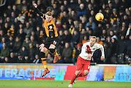 Hull City midfielder Sam Clucas (11) heads ball clear of Chris Solly of Charlton Athletic during the Sky Bet Championship match between Hull City and Charlton Athletic at the KC Stadium, Kingston upon Hull, England on 16 January 2016. Photo by Ian Lyall.
